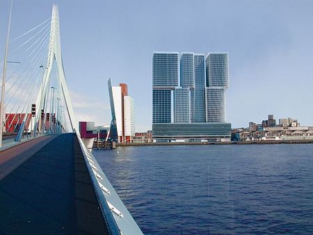 De naam van het gebouw (in feite drie aan elkaar geplakte torens van 44 bouwlagen) refereert aan het vlaggenschip ROTTERDAM dat in vroegere tijden vanaf de Wilhelminakade voor de Holland-Amerika Lijn (HAL) tienduizenden Europese emigranten naar de Verenigde Staten verhuisde. Foto: Vastgoedjournaal