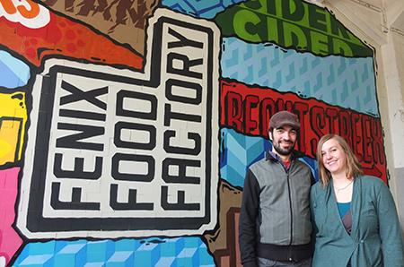 Christine Bosch en Folco de Jong voor het pand van de Fenix Food Factory. Nog deze zomer kan de nieuwe literaire boekhandel werkelijkheid zijn. Foto: Privé